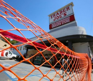 Access is blocked to a Trader Joe's grocery store in the Los Feliz neighborhood of Los Angeles, Sunday, July 22, 2018. (AP Photo/Damian Dovarganes)