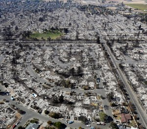 Photo shows an aerial view of the devastation of the Coffey Park neighborhood after the Tubbs Fire swept through in Santa Rosa, Calif.  (Photo/AP, Marcio Jose Sanchez)
