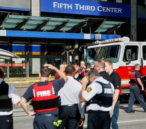 In this Sept. 6, 2018, file photo, emergency personnel and police respond to reports of an active shooter situation near Fountain Square in downtown Cincinnati. (AP Photo/John Minchillo, File)