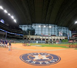 A dugout paramedic is suing the Houston Astros after he was struck by foul ball during the 2019 American League Championship Series. (AP Photo/Frank Franklin II)