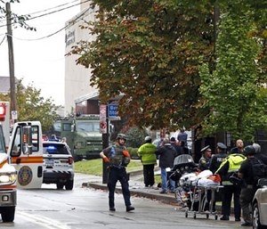 First responders surround the Tree of Life Synagogue in Pittsburgh, Pa., where a shooter opened fire Saturday, Oct. 27, 2018.