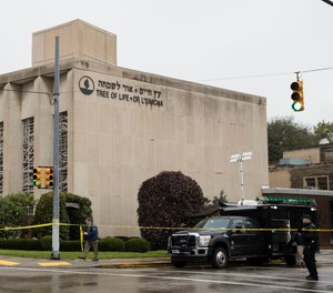 Police stand guard outside the Tree of Life Synagogue in Pittsburgh where a shooter opened fire Saturday, Oct. 27, 2018.