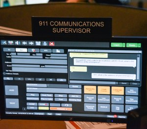 This file photo shows a 911 call center with one of the computer screens used by dispatchers showing a text message that has come into the system. New York City is expected to launch a text-to-911 service next summer, after years of delays. (AP Photo/Lisa Marie Pane, File)