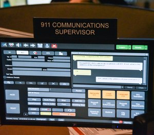 This file photo shows a 911 call center with one of the computer screens used by dispatchers showing a text message that has come into the system. New York City is expected to launch a text-to-911 service next summer, after years of delays.