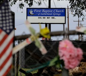Memorials and messages hang on a fence at the First Baptist Church of Sutherland Springs, Wednesday, Oct. 31, 2018, in Sutherland Springs, Texas, one year since a gunman opened fire on worshippers attending Sunday service at the church, killing more than two dozen people and wounding others.