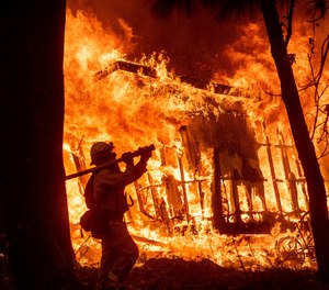 In addition to the heavy burden of protecting life, directing the evacuation of tens of thousands of people, and caring for the injured; dozens of firefighters, EMTs, paramedics and police officers have lost their homes. (Photo/AP)