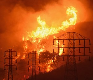 State firefighters are taking on the colossal task this year of updating maps that highlight the most fire-prone areas in California. (Photo/AP)