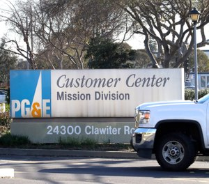 In this photo taken on Wednesday, Jan. 23, 2019, a Pacific Gas & Electric truck enters their customer center in Hayward, Calif. (AP Photo/Ben Margot)