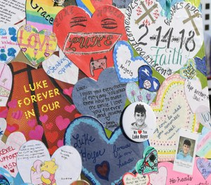 A memorial at the Marjory Stoneman Douglas High School where 14 students and three staff members were killed during a mass shooting.