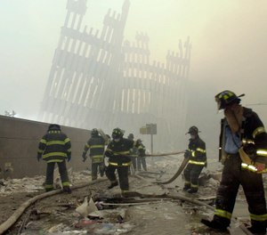 New York City firefighters work amid debris on Cortlandt St. after the terrorist attacks. (Photo/AP by Mark Lennihan)