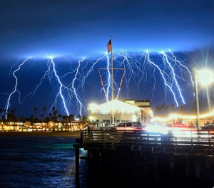 This time exposure photo provided by the Santa Barbara County Fire Department shows a series of lightning strikes over Santa Barbara, Calif., seen from Stearns Wharf in the city's harbor, Tuesday evening, March 5, 2019. A storm soaking California on Wednesday could trigger mudslides in wildfire burn areas where thousands of residents are under evacuation orders, authorities warned. (Mike Eliason/Santa Barbara County Fire Department via AP)