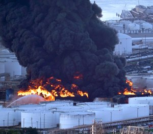 Firefighters battle a petrochemical fire at the Intercontinental Terminals Company Monday, March 18, 2019, in Deer Park, Texas. The large fire at a Houston-area petrochemicals terminal will likely burn for another two days, authorities said Monday, noting that air quality around the facility was testing within normal guidelines.