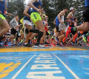 Runners cross the start line of the 123rd Boston Marathon on Monday, April 15, 2019, in Hopkinton, Mass.