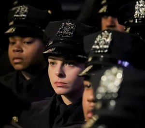 New York City Police Academy graduates listen during their graduation ceremony, adding 457 new members of the NYPD, Thursday April 18, 2019, in New York. (AP Photo/Bebeto Matthews)