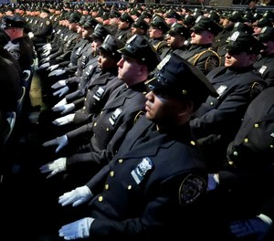 We can intensify recruitment for police departments to be more representative of the languages and cultures found in the areas we police. (AP Photo/Bebeto Matthews)