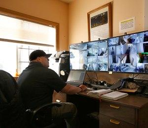 California Correctional Officer Alejandro Martinez monitors surveillance cameras at the Male Community Re-entry Program an alternative custody unit in Oroville, Calif.