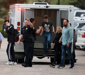 Students exit an ambulance at a recreation center for students to get reunited with their parents after a shooting at a suburban Denver middle school Tuesday, May 7, 2019, in Highlands Ranch, Colo.