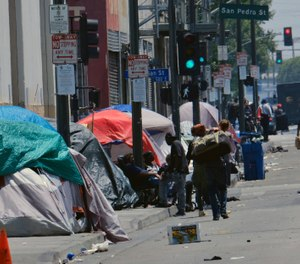 Tents housing homeless line a street down the street from LAPD Central Community Police Station in downtown Los Angeles on Thursday, May 30, 2019. (AP Photo/Richard Vogel)
