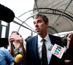 Democratic presidential candidate Beto O'Rourke is surrounded by reporters as he walks on an international bridge to cross into Ciudad Juarez, Mexico. O'Rourke crossed the border into Mexico for the funeral of one of the 22 people killed in a mass shooting at a Walmart in El Paso, Texas. (Photo/AP, Christian Chavez)