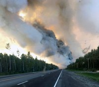 """Firefighters injured after falling on """"ash pits"""" fighting Alaskan fires"""