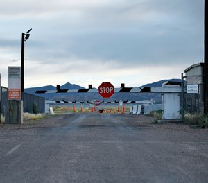 A sign warns about trespassing at an entrance to the Nevada Test and Training Range near Area 51 outside of Rachel, Nevada. Officials in Nevada's rural Lincoln County have drafted an emergency declaration and are planning with state officials to handle possible crowds that might arrive for an event next month dubbed