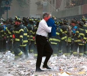 First responders at the World Trade Center. (Photo/AP, 1203845Globe, MediaPunch, IPX)