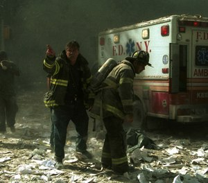Firefighters at World Trade Center after the first building was struck. (Photo/AP, 1207223Globe, MediaPunch, IPX)