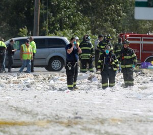 Firefighters looks through debris at the scene of an explosion Monday, Sept. 16, 2019, in Farmington, Maine. The town of Farmington faces $22,000 in fines from the Maine Department of Labor, which says firefighters who went to investigate an initial gas leak at the site did not have proper training or equipment. (AP Photo/Robert F. Bukaty)