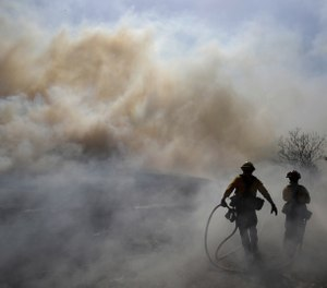 New research shows that exposure to air pollution, including wildfire smoke, can make coronavirus particularly deadly. (AP Photo/Marcio Jose Sanchez)