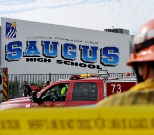 First responders standby for any injured students after a gunman opened fire at Saugus High School on Thursday, Nov. 14, 2019, in Santa Clarita, Calif. (AP Photo by Christian Monterrosa)