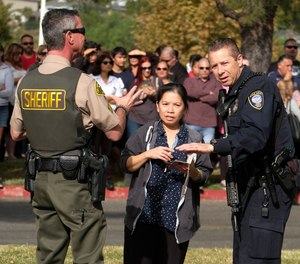 Parents wait to reunite with their children after a shooting at Saugus High School in Santa Clarita, Calif., Thursday, Nov. 14, 2019.