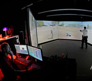 An officer takes part in a police training exercise using an immersive VirTra virtual firearms training simulator. (AP Photo/Ted S. Warren)