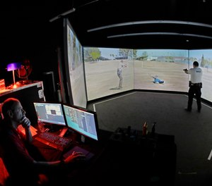 An officer takes part in a police training exercise using an immersive VirTra virtual firearms training simulator.