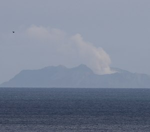 A plume of steam is seen above White Island early morning off the coast of Whakatane, New Zealand, Tuesday, Dec. 10, 2019. A volcanic island in New Zealand erupted Monday Dec. 9 in a tower of ash and steam while dozens of tourists were exploring the moon-like surface, killing at least five people and leaving many more missing.