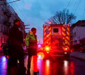 First responders and law enforcement personnel stand near the scene following a shooting, Tuesday, Dec. 10, 2019, in Jersey City, N.J. (AP Photo/Eduardo Munoz Alvarez)