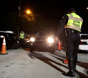 Checkpoints have long been a common tool for fighting impaired driving. (AP Photo/Lynne Sladky)