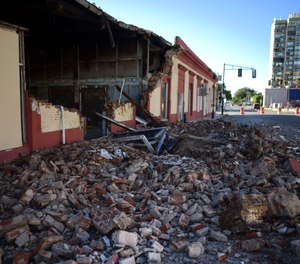 Debris from a collapsed wall of a building litters the ground after an earthquake struck Puerto Rico before dawn, in Ponce, Puerto Rico, Tuesday, Jan. 7, 2020.