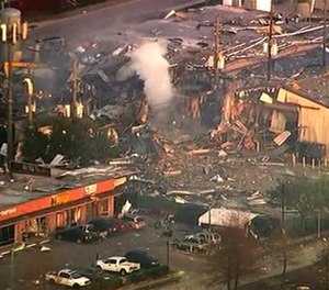 This aerial photo taken from video provided by KTRK-TV shows damage to buildings after an explosion in Houston on Friday, Jan. 24, 2020. A large explosion left rubble scattered in the area, damaged nearby homes and was felt for miles away. A fire continues to burn and people have been told to avoid the area. (Photo/KTRK-TV via AP)