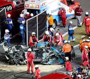 Ryan Newman is moved to an ambulance after rescue workers removed him from his car after he was involved in a crash on NASCAR Daytona 500 auto race at Daytona International Speedway, Monday, Feb. 17, 2020, in Daytona Beach, Fla. (AP Photo/David Graham)