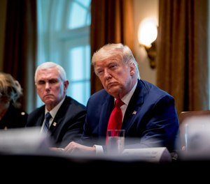 President Donald Trump and Vice President Mike Pence attend a meeting with pharmaceutical executives on the coronavirus in the Cabinet Room of the White House, Monday, March 2, 2020, in Washington. (AP Photo/Andrew Harnik)
