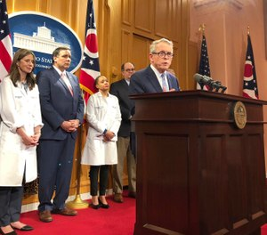Ohio Gov. Mike DeWine speaks at a news conference at the statehouse in Columbus, Ohio, Tuesday, March 3, 2020. Ohio lawmakers have proposed a bill that would require hospitals and health departments to notify first responders of COVID-19 exposure. (AP Photo/Julie Carr Smyth)