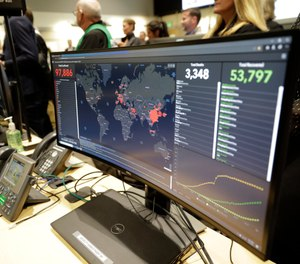 A monitor displays world-wide statistics relating to the spread of the COVID-19 coronavirus during a visit of Vice President Mike Pence to the Washington State Emergency Operations Center, Thursday, March 5, 2020 at Camp Murray in Washington state. (AP Photo/Ted S. Warren)