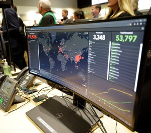 A monitor displays world-wide statistics relating to the spread of the COVID-19 coronavirus during a visit of Vice President Mike Pence to the Washington State Emergency Operations Center, Thursday, March 5, 2020 at Camp Murray in Washington state.