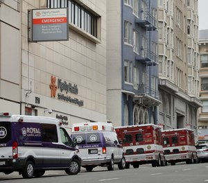 Ambulances park in front of Saint Francis Memorial Hospital on Wednesday, March 18, 2020, in San Francisco. The NHTSA's Office of EMS will be hosting a webinar with an expert panel on Thursday to discuss prehospital crisis standards of care during the COVID-19 pandemic.