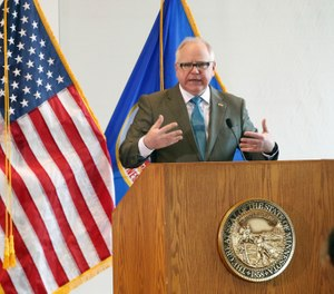 Minnesota Gov. Tim Walz gives an update on the state's COVID-19 efforts on Mar. 18, 2020. Walz has issued an executive order extending the deadline for state-issued EMS certification renewals from March 31, 2020 to June 30, 2020. (AP Photo/Jim Mone)
