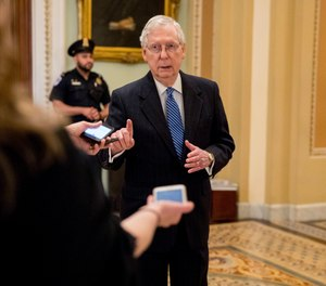 Senate Majority Leader Mitch McConnell of Ky. speaks to reporters outside the Senate chamber after Democrats block a coronavirus aid package on Capitol Hill, Monday, March 23, 2020, in Washington. (AP Photo/Andrew Harnik)