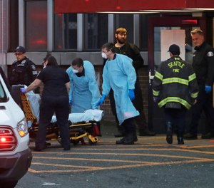 Police, fireand EMS personnel respond to a medical call in Seattle, Tuesday, March 24, 2020. (AP Photo/Ted S. Warren)