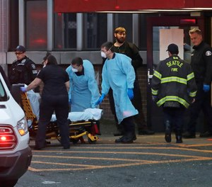 Police, fireand EMS personnel respond to a medical call in Seattle, Tuesday, March 24, 2020.