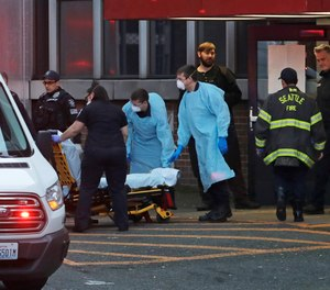 Police, fire and EMS responders respond to a medical call in Seattle, Tuesday, March 24, 2020. The city has booked an entire hotel in the downtown area for first responder quarantine and isolation.
