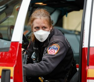 The new normal will require more EMS, and when the next pandemic hits - not if, but when -  we'll need even more trained providers able to cross state and county lines to manage the surge. (Photo/AP)